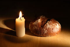 bread-candle-rye-near-lighting-wooden-background-34564139